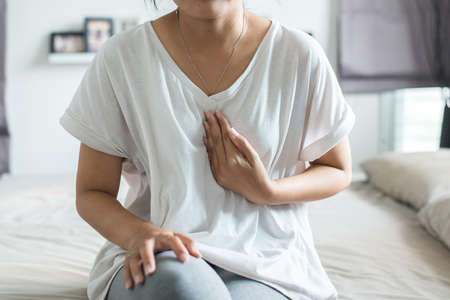 Gastroesophageal reflux disease,Because the esophageal sphincter that separates the esophagus and stomach dysfunction,Asian female having or symptomatic reflux acids Stock Photo