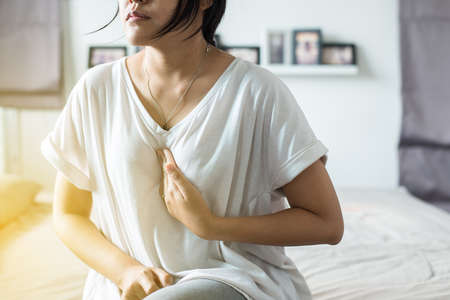 Asian woman having or symptomatic reflux acids,Gastroesophageal reflux disease,Because the esophageal sphincter that separates the esophagus and stomach dysfunction Stok Fotoğraf - 104341335