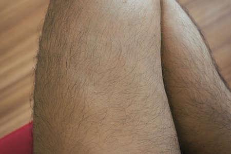 Legs hair of asian man close up