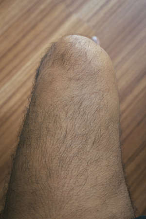 Legs hair of asian man close up