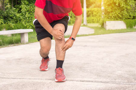 Man suffering from pain in leg injury after sport exercise running jogging and workout outdoor