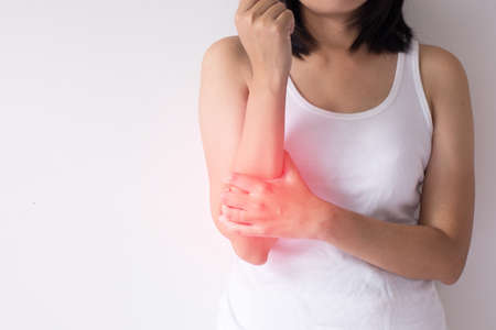 Woman with pain in the arm,Female hand touching her painful arms