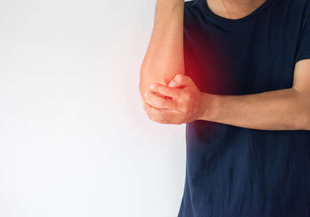 Man with pain in the elbow,Male hand touching his painful elbows Banque d'images