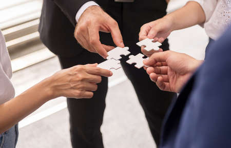 Group of business people making jigsaw and merging,Connecting together,Business thinking concept Stock Photo
