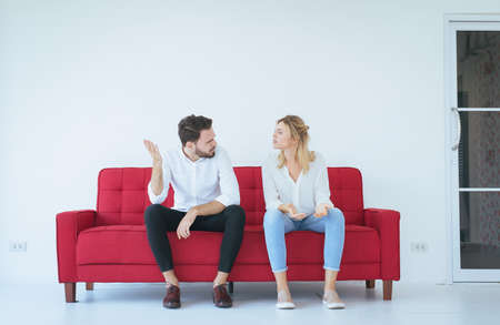 Husband quarreling with wife conflict and boring couple in the living room,Negative emotions