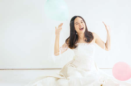 Happy young bride asian woman smiling with colorful balloons