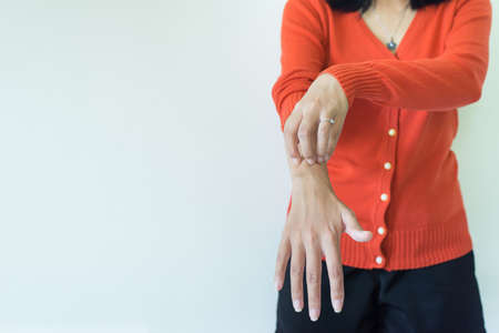 Asian woman scratch itch with her arm,Itching and scratching,Copy space on white blackground