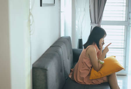 Wife reconcile talking mobilephone to her husband at the living room,Negative attitude emotions