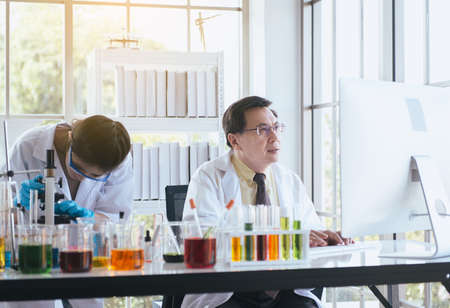 Group of asian scientist working and explaining research information together in the laboratary