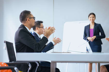 Business people hands clapping after meeting,Group of success presentation and coaching seminar at office