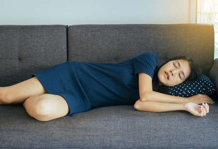 Women sleeping on sofa bed and grinding teeth,Female tiredness and stress at living room