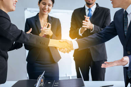 Business asian team people shaking hands after finishing up meeting in conference room Reklamní fotografie
