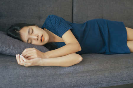 Women sleeping on the bed and grinding teeth,Female tiredness and stress Banco de Imagens