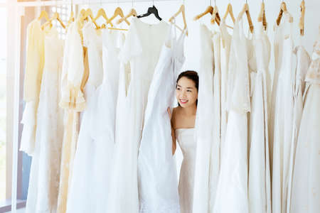 Ceremony in wedding day,Happy and smiling,Portrait of beautiful asian woman bride in white dress cheerful and funny
