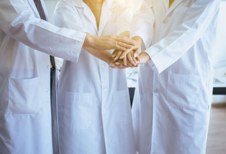 Scientists coordinate hands,Group of diversity people teamwork in laboratory,Successful and reserch working