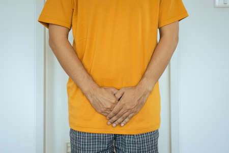 Hands man holding his crotch,Men need to pee,Urinary incontinence Stock Photo