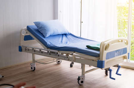 Empty sick bed at hospital room for supporting patients