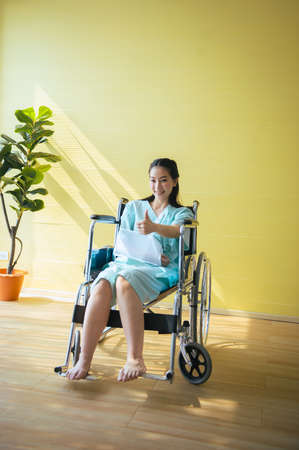 Beautiful asian women patient showing thumb up,Positive thinking,Insurance policy concept