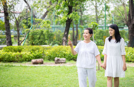 Portrait of a elderly asian woman with young women walking outdoor together in the morning,Positive thinking