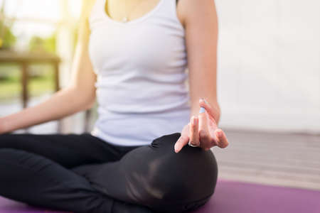 Close up of hand woman practices yoga and meditation on the lotus posture