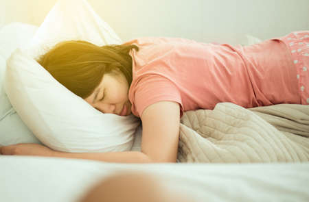 Asian woman sleeping on bed,Good dream,Daydream,Happy time Reklamní fotografie