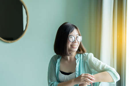 Portrait of beautiful asian woman relax and sitting near window at home,Positive thinking,Good attitude