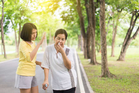 Elderly asian women with faint and using inhaler,Take care and support concept