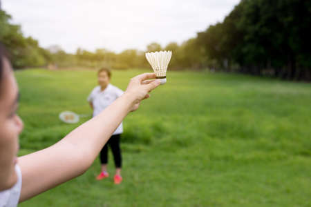 Couple asian woman hands holding badminton racket and shuttlecock in public park,Close up Stockfoto