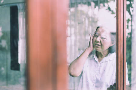 Mature asian elderly woman having a headache pain, Senior healthy concept