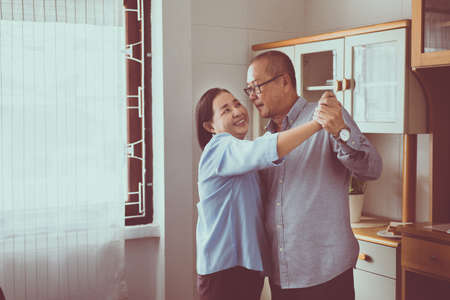 Senior asian couple dancing enjoying at home together,Having fun and love live forever