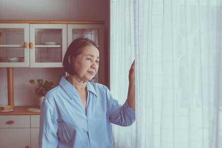 Alzheimer asian elderly woman having migraine and headache pain,Senior healthy concept