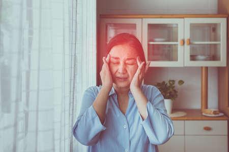 Senior healthy concept,Mature asian elderly woman having migraine and headache pain