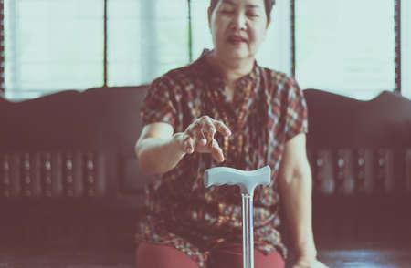 Elderly woman suffering with parkinsons disease symptoms on hand Stok Fotoğraf