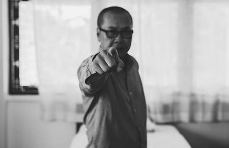 Senior asian man points his finger to you,Close up,Black and white toned,Selective focus Stok Fotoğraf