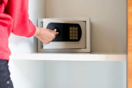 Woman hand open electronic safe at home,Secret password,Close up Stock Photo