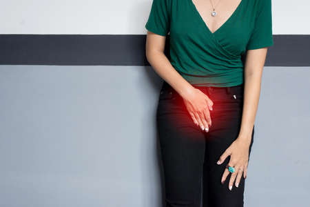 Incontinence problem,Hands woman holding her crotch,Female need to pee Foto de archivo