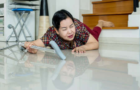 Senior asian woman suffering from falling down of staircase at home Stock Photo