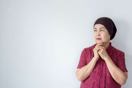 Senior asian woman with disease cancer standing on white background,Female felling depress and upset,chemotherapy 스톡 콘텐츠