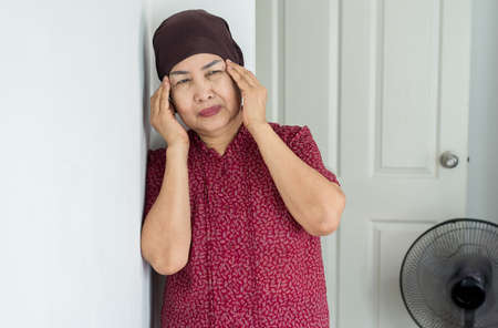 Elderly asian woman depression of lonely have a headache at home,Mental disorder health care,World suicide prevention day concept Stock Photo - 129885548