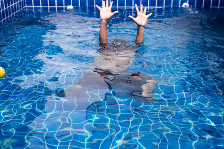 Blurred of hands man drowning in swimming pool Stock Photo - 129885563