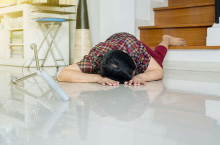 Senior asian woman suffering with faint lying on floor after falling down stair at home Archivio Fotografico - 131070601