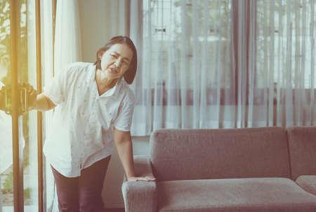 Senior healthy concept,Mature asian elderly woman having faint and headache pain Imagens