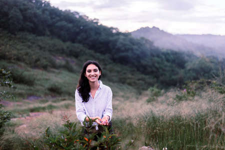 Portrait of young beautiful woman looking camera with happy and smiling,Travel at outdoor