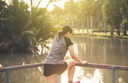 Asian woman on bridge with depression,Suicide prevention concept