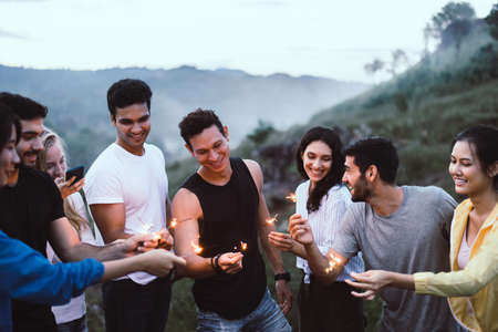 Group of diversity friends with sparklers and enjoying  together at outdoor,Happy and smiling Imagens