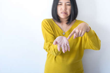 Asian woman with hand removes flaky skin,Health care skin concept