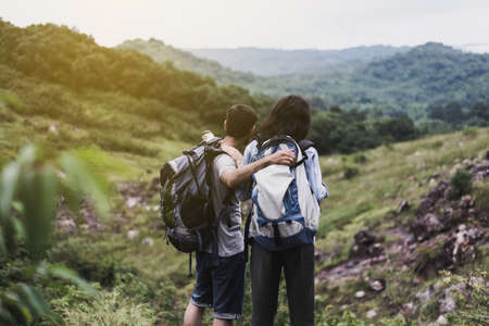 Couple lover standing and looking beautiful view feeling happy and smiling together,Enjoying camping in nature