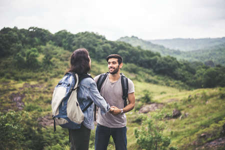 Couple lover standing and talking feeling happy and smiling together,Enjoying camping in nature