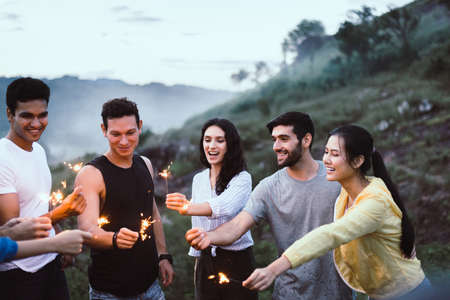 Group of diversity friends cheerful with sparklers and enjoying together at outdoor,Happy and smiling