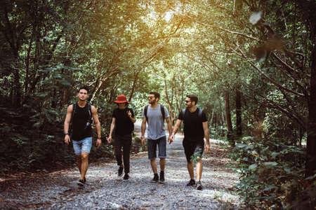 Group of traveler friends walking together at rain forest,Enjoying backpacking concept Imagens